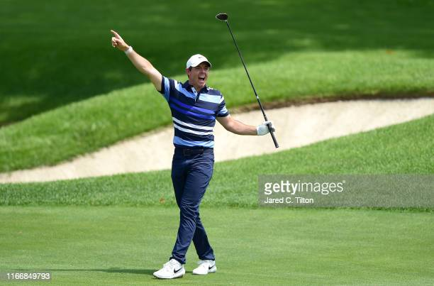 Rory McIlroy of Northern Ireland reacts to a shot on the eighth fairway during the first round of The Northern Trust at Liberty National Golf Club on...