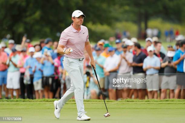 Rory McIlroy of Northern Ireland reacts to his birdie on the 13th green during the final round of the TOUR Championship at East Lake Golf Club on...