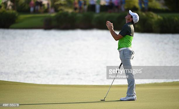 Rory McIlroy of Northern Ireland reacts to his birdie outt on the par three 17th hole during the third round of the DP World Tour Championship on the...