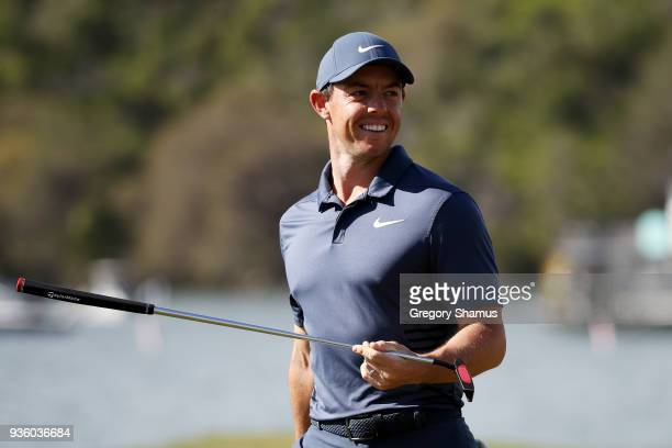 Rory McIlroy of Northern Ireland reacts to his birdie putt on the 14th green during the first round of the World Golf ChampionshipsDell Match Play at...