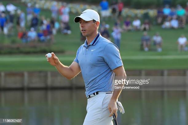 Rory McIlroy of Northern Ireland reacts to his eagle on the 16th green during the second round of The PLAYERS Championship on The Stadium Course at...