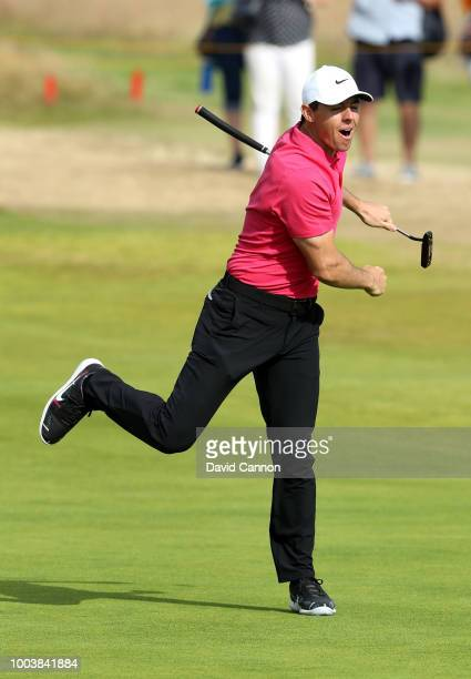 Rory McIlroy of Northern Ireland reacts to his eagle putt on the 14th hole green during the final round of the Open Championship at Carnoustie Golf...