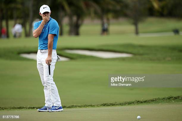 Rory McIlroy of Northern Ireland reacts to his missed birdie putt on the 16th hole during the second round of the World Golf ChampionshipsCadillac...