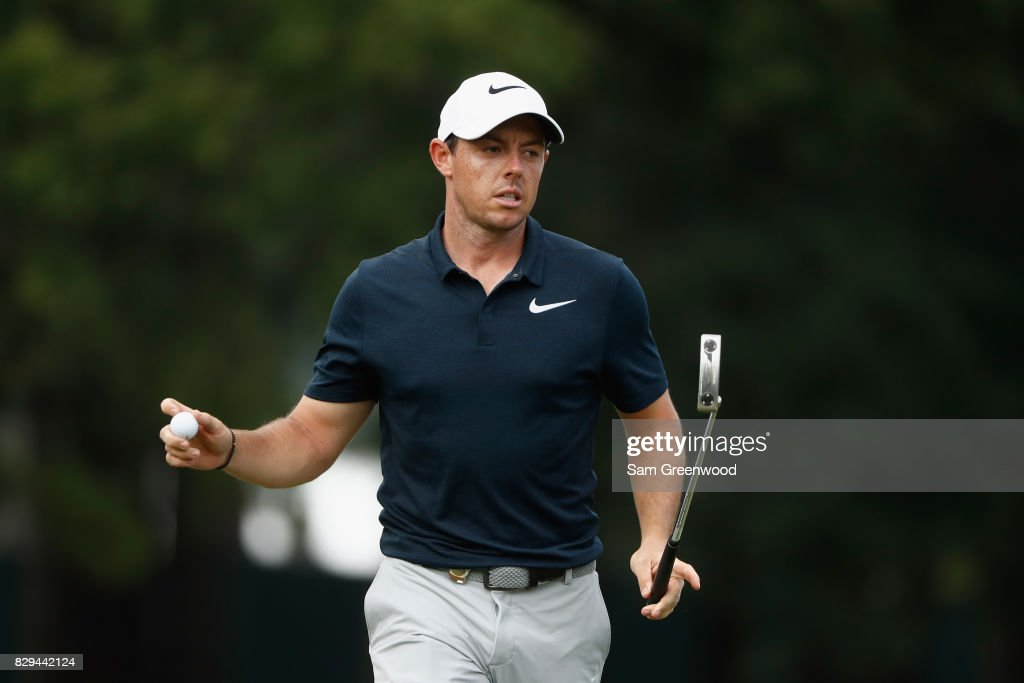 Rory McIlroy of Northern Ireland reacts to his putt on the 12th hole during the first round of the 2017 PGA Championship at Quail Hollow Club on August 10, 2017 in Charlotte, North Carolina.
