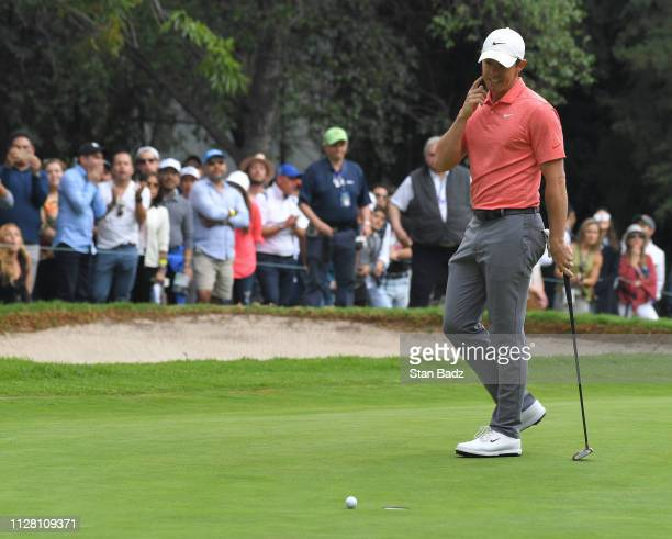 Rory McIlroy of Northern Ireland reacts to his putt on the ninth hole during the final round of the World Golf Championships-Mexico Championship at...