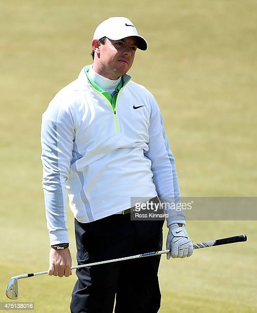 Rory McIlroy of Northern Ireland reacts to his second shot on the par five 1st hole during the second Round of the Dubai Duty Free Irish Open hosted...