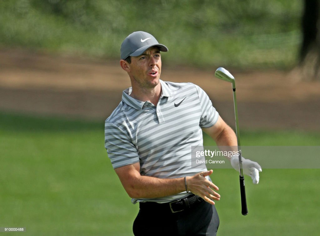 Rory McIlroy of Northern Ireland reacts to his second shot on the par 4, ninth hole during the first round of the Omega Dubai Desert Classic on the Majlis Course at Emirates Golf Club on January 25, 2018 in Dubai, United Arab Emirates.