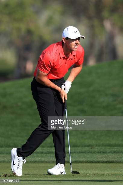 Rory McIlroy of Northern Ireland reacts to his second shot on the 16th hole during round three of the Abu Dhabi HSBC Golf Championship at Abu Dhabi...