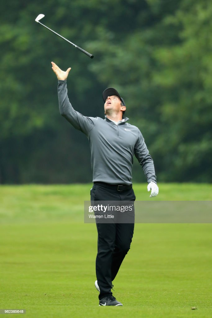 Rory McIlroy of Northern Ireland reacts to his second shot on the 17th hole during the second round of the BMW PGA Championship at Wentworth on May 25, 2018 in Virginia Water, England.