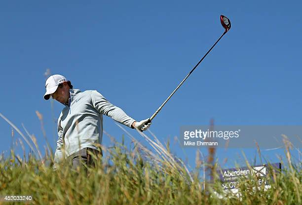 Rory Mcilroy of Northern Ireland reacts to his tee shot on the 12th hole during the second round of the 2014 Aberdeen Asset Management Scottish Open...