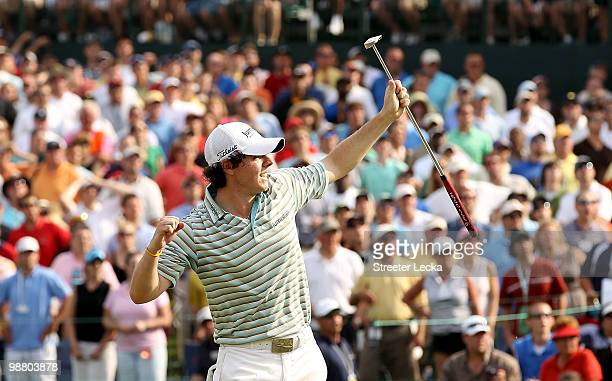 Rory McIlroy of Northern Ireland reacts to making a birdie on the 18th green during the final round on his way to winning the Quail Hollow...