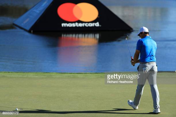 Rory McIlroy of Northern Ireland reacts to missing a par putt on the 18th green during the final round of the Arnold Palmer Invitational Presented By...