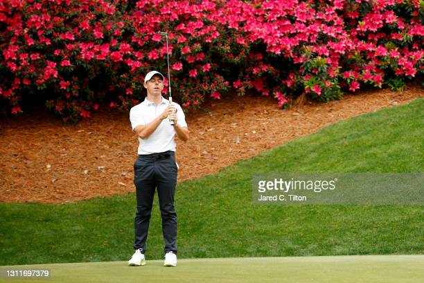 Rory McIlroy of Northern Ireland reacts to missing a putt on the 13th green during the second round of the Masters at Augusta National Golf Club on...
