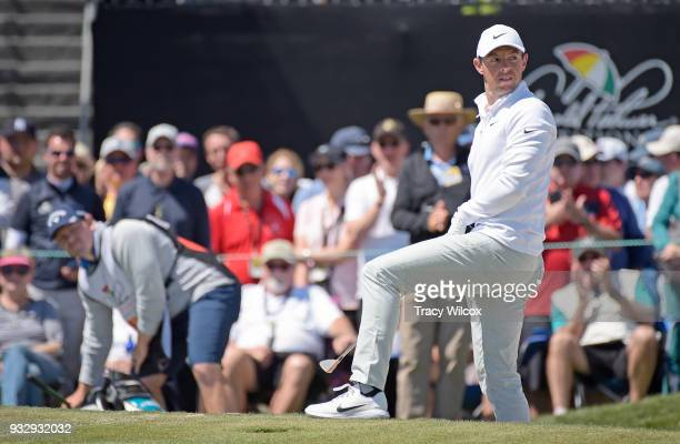 Rory McIlroy of Northern Ireland reacts to nearing holing out of a bunker at No 9 during the second round of the Arnold Palmer Invitational presented...