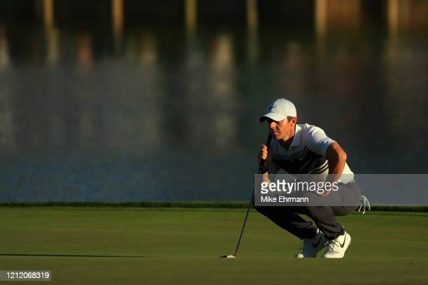 Rory McIlroy of Northern Ireland reads a putt on the 17th green during the first round of The PLAYERS Championship on The Stadium Course at TPC...