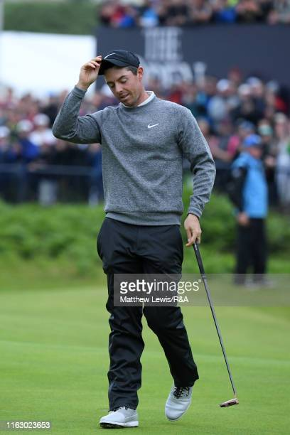 Rory McIlroy of Northern Ireland removes his cap on the eighteenth hole at the end of his round during the second round of the 148th Open...
