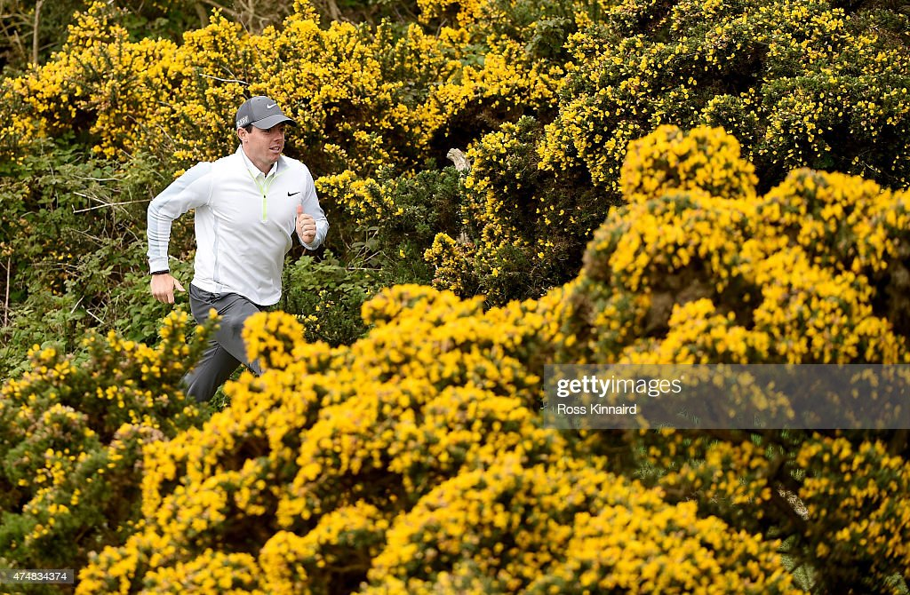 Rory McIlroy of Northern Ireland running through the gorse during the pro-am event prior to The Irish Open at Royal County Down Golf Club on May 27, 2015 in Newcastle, Northern Ireland.