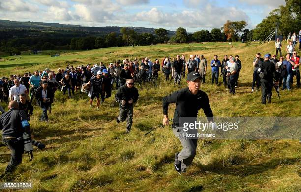 Rory McIlroy of Northern Ireland runs to the 17th green during day one of the British Masters at Close House Golf Club on September 28 2017 in...