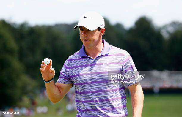 Rory McIlroy of Northern Ireland saves par on the first hole during the first round of the TOUR Championship by Coca-Cola at the East Lake Golf Club...