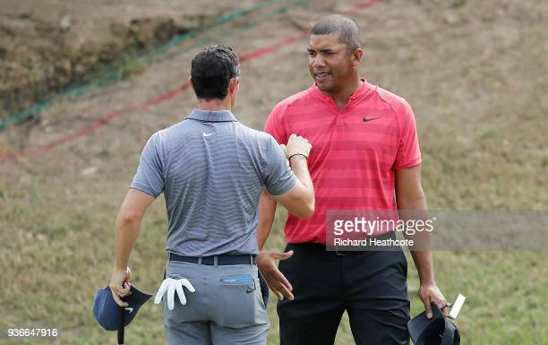 Rory McIlroy of Northern Ireland shakes hands with Jhonattan Vegas of Venezuela after defeating him 21 on the 17th green during the second round of...