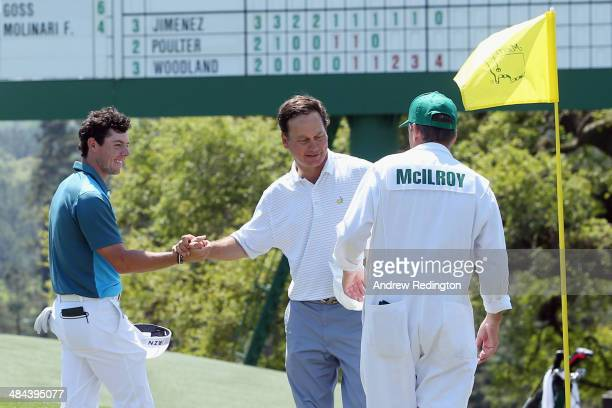 Rory McIlroy of Northern Ireland shakes hands with markerJeff Knox on the 18th green during the third round of the 2014 Masters Tournament at Augusta...