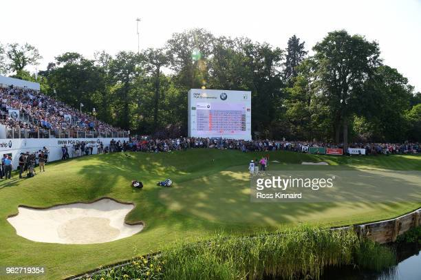 Rory McIlroy of Northern Ireland shakes hands with Sam Horsfield of England on the 18th green during the third round of the BMW PGA Championship at...