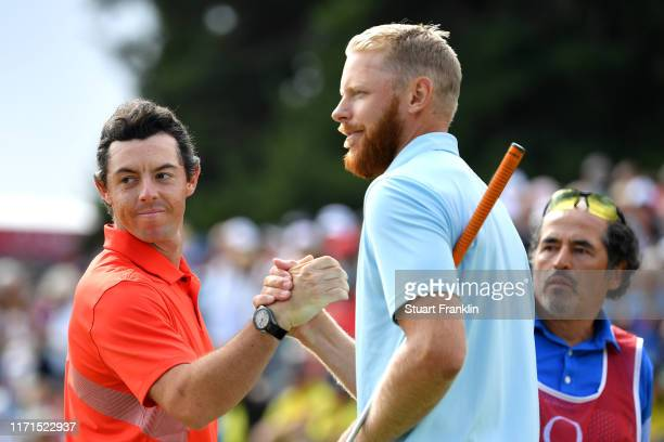 Rory McIlroy of Northern Ireland shakes hands with Sebastian Soderberg of Sweden on the eighteenth during Day Four of the Omega European Masters at...