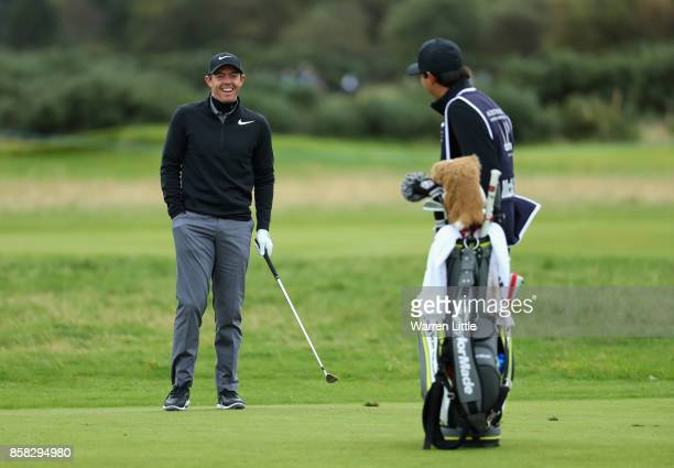 Rory McIlroy of Northern Ireland shares a joke with his caddie during day two of the 2017 Alfred Dunhill Championship at Carnoustie on October 6 2017...