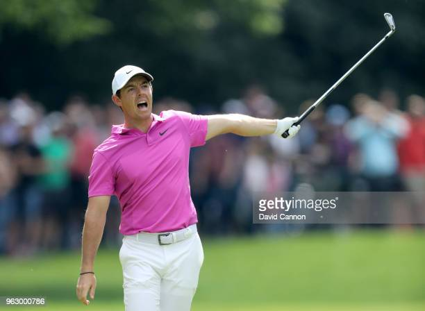Rory McIlroy of Northern Ireland signals that his second shot has gone left towards the crowds on the par 5, 17th hole during the final round of the...