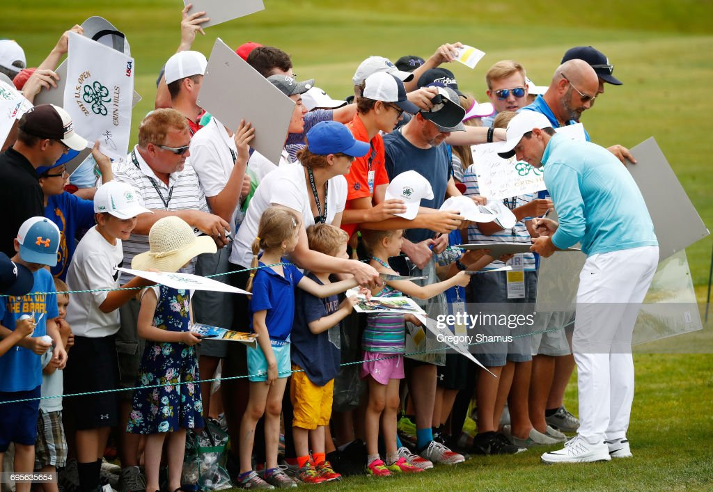 Rory McIlroy of Northern Ireland signs autographs during a practice round prior to the 2017 U.S. Open at Erin Hills on June 13, 2017 in Hartford, Wisconsin.