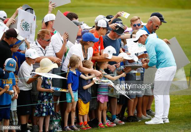Rory McIlroy of Northern Ireland signs autographs during a practice round prior to the 2017 US Open at Erin Hills on June 13 2017 in Hartford...