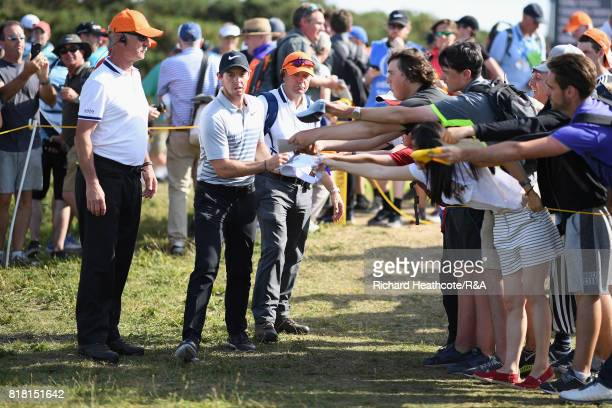 Rory McIlroy of Northern Ireland signs autographs during a practice round prior to the 146th Open Championship at Royal Birkdale on July 18 2017 in...