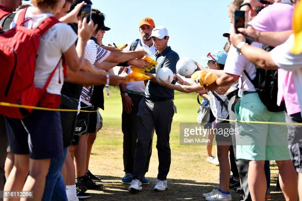 Rory McIlroy of Northern Ireland signs autographs for the fans during a practice round prior to the 146th Open Championship at Royal Birkdale on July...