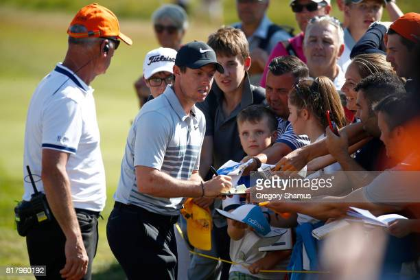 Rory McIlroy of Northern Ireland signs autographs for the golf fans during a practice round prior to the 146th Open Championship at Royal Birkdale on...