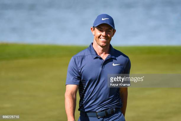 Rory McIlroy of Northern Ireland smiles after making a long birdie putt on the 14th hole green during round one of the World Golf ChampionshipsDell...