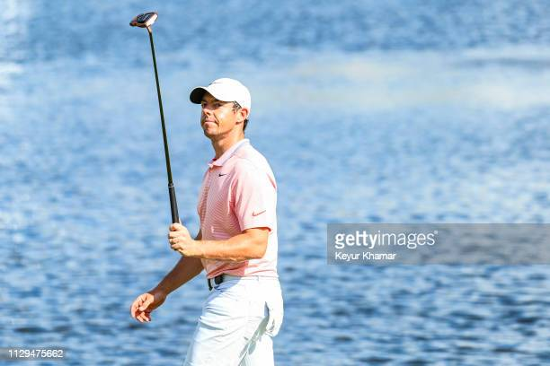 Rory McIlroy of Northern Ireland smiles and raises his putter to acknowledge fans on the 18th hole green during the third round of the Arnold Palmer...