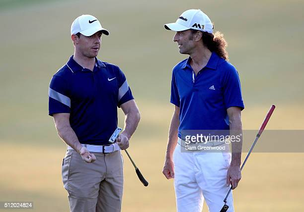 Rory McIlroy of Northern Ireland speaks with musician Kenny G during a proam round as a preview for The Honda Classic at PGA National Resort and Spa...
