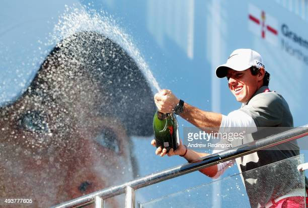 Rory McIlroy of Northern Ireland sprays champagne following his victory at the end of day four of the BMW PGA Championship at Wentworth on May 25,...