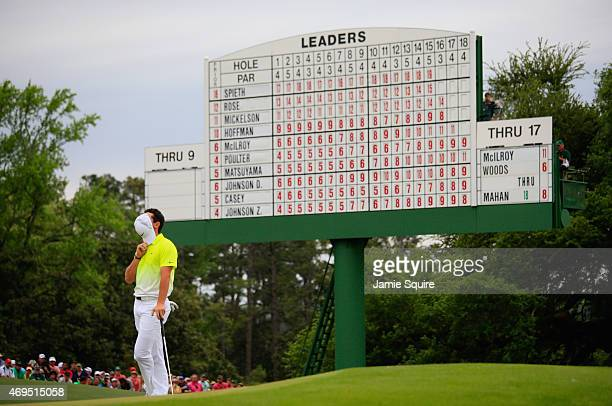 Rory McIlroy of Northern Ireland stands on the 18th green during the final round of the 2015 Masters Tournament at Augusta National Golf Club on...