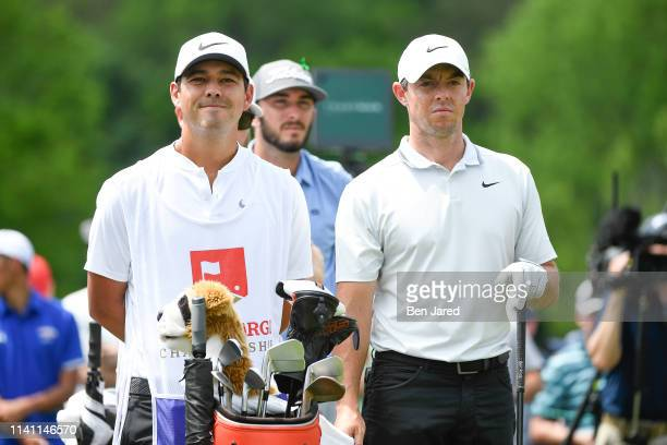 Rory McIlroy of Northern Ireland stands with his caddie Harry Diamond on the eighth tee during the third round of the Wells Fargo Championship at...