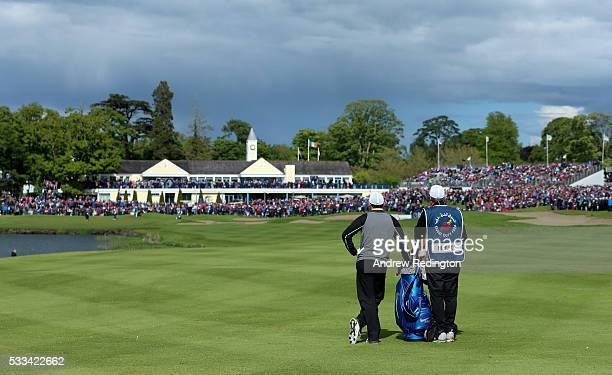 Rory McIlroy of Northern Ireland stands with his caddie JP Fitzgerald on the 18th hole during the final round of the Dubai Duty Free Irish Open...