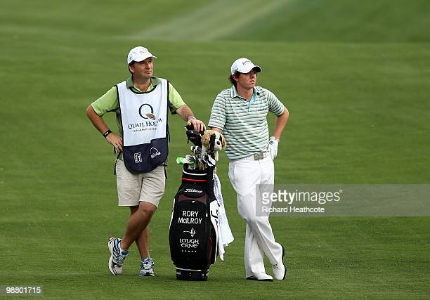 Rory McIlroy of Northern Ireland stands with his caddy J.P. Fitzgerald on the 15th fairway during the final round of the Quail Hollow Championship at...