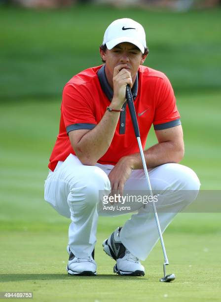 Rory McIlroy of Northern Ireland studies the 13th green during the first round of the Memorial Tournament presented by Nationwide Insurance at...