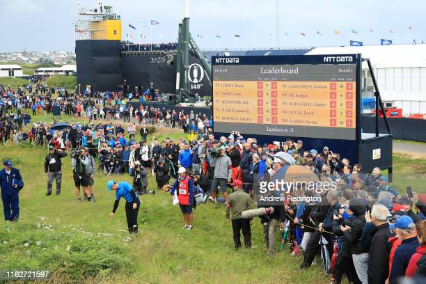 Rory McIlroy of Northern Ireland takes a penalty drop on the first hole during the first round of the 148th Open Championship held on the Dunluce...