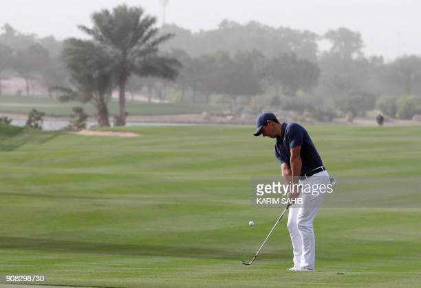 Rory McIlroy of Northern Ireland takes a shot during the final round of the Abu Dhabi HSBC Golf Championship at the Abu Dhabi Golf Club on January 21...