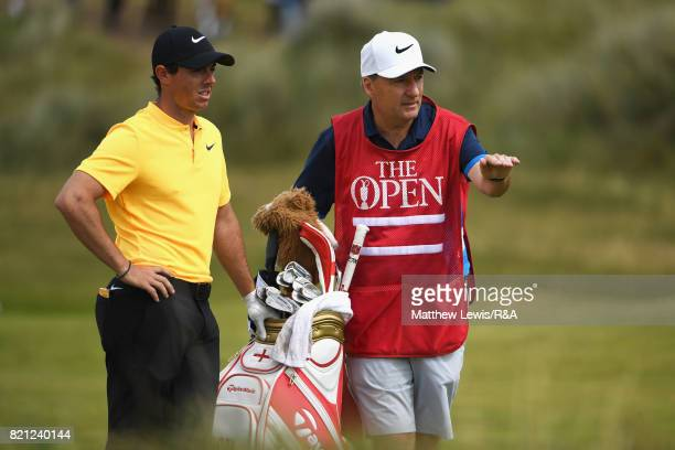 Rory McIlroy of Northern Ireland talks to caddie JP Fitzgerald on the 10th hole during the final round of the 146th Open Championship at Royal...