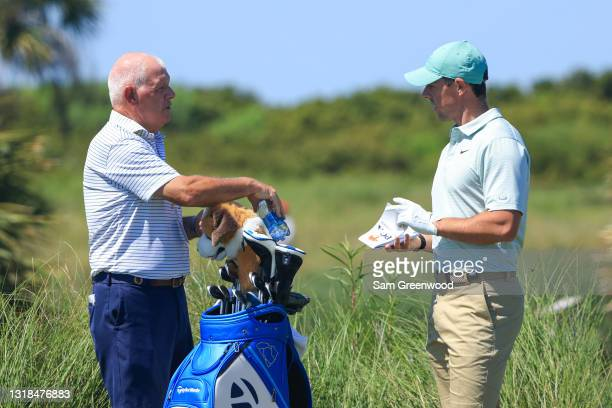 Rory McIlroy of Northern Ireland talks to his father Gerry McIlroy during a practice round prior to the 2021 PGA Championship at Kiawah Island...
