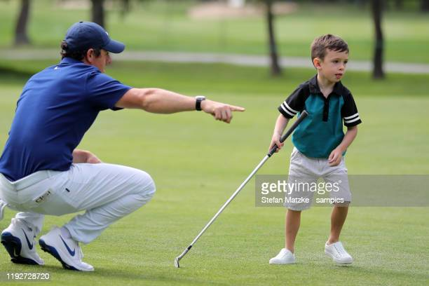 Rory McIlroy of Northern Ireland talks to Silas son of musician Justin Timberlake and his wife Jessica Biel ahead of the ProAm prior to the start of...