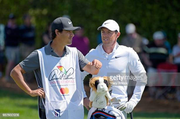 Rory McIlroy of Northern Ireland talks with his caddie Harry Diamond at hole No 9 during the second round of the Arnold Palmer Invitational presented...