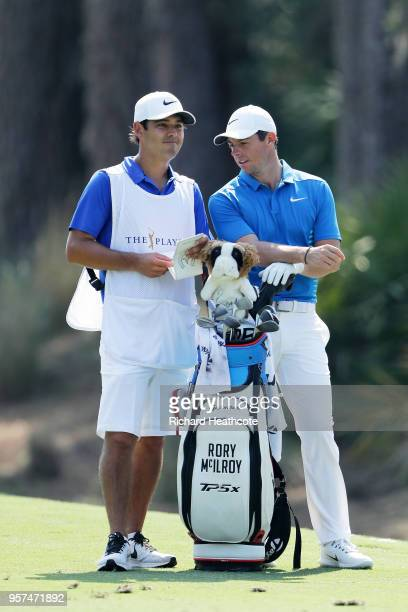 Rory McIlroy of Northern Ireland talks with his caddie Harry Diamond during the second round of THE PLAYERS Championship on the Stadium Course at TPC...